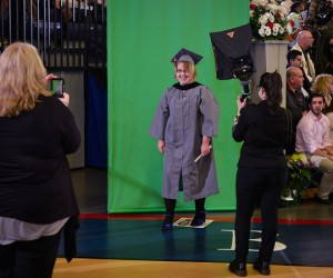 Graduate getting photo taken after crossing stage