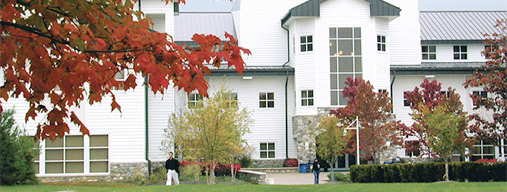 The south entrance to Larrison Hall in the autumn